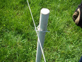Bend and wrap cotter pin tails around PasturePro post